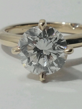Photo of gold diamond engagement ring Crown Point.